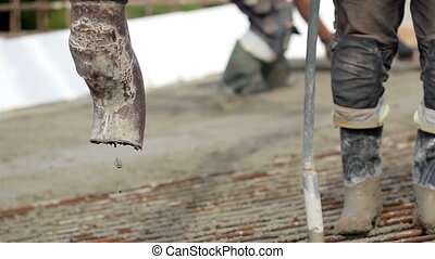 Cement mixer pouring cement on the ground