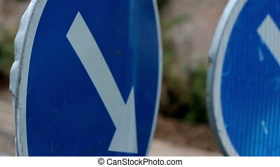 Blue down arrow sign standing in the right side of the road...