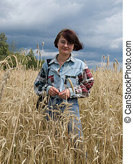 agriculturist woman - young agriculturist woman in rye field...