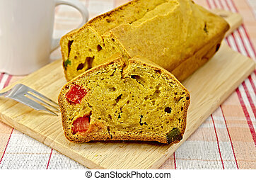 Fruitcake pumpkin with candied fruit on a napkin - Fruitcake...