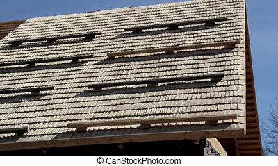 Newly Cedar wooden shingles shakes roof roofing roofworking...