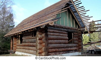 Small log house Cedar wooden shingles roof roofing...