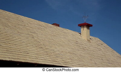A more closer image of the wooden roof tiles. The view...