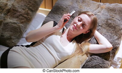 Young woman talking on phone.