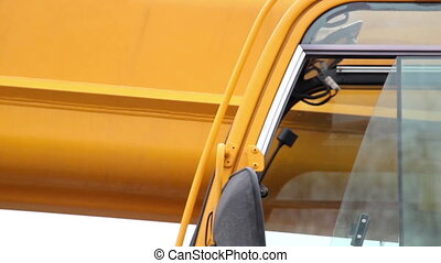 Close image of the side mirror of the yellow construction...