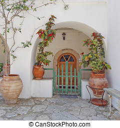 house door and flowerpots in a Mediterranean island