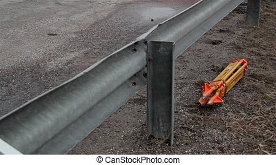 Man going over the metal steel beam at the side of the road...