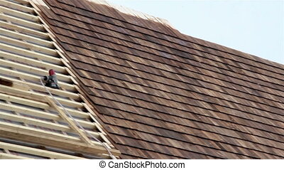 Half finished pine tared cedar wooden shingle roof - Half...