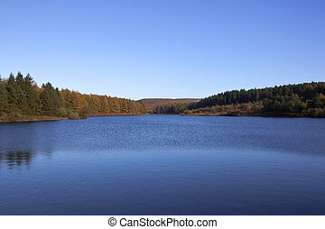 cod beck reservoir - english autumn landscape with the blue...