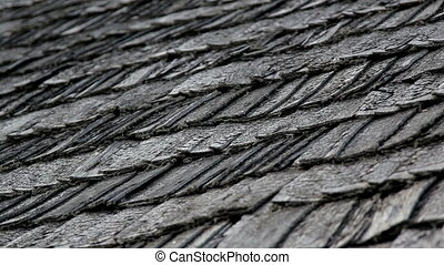 The old cedar wooden shingle shake roof of the house - An...