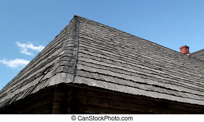 The corner of old cedar wooden shingle shake roof of the...