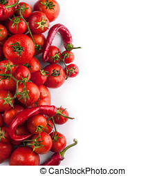Fresh tomatoes and pepper with drops of water