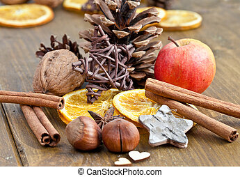 Winter spices for christmas on a wooden background