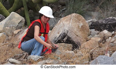 Geologist Woman Loupe - Female geologist or prospector picks...