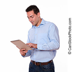 Charming man using his tablet pc - Portrait of a charming...