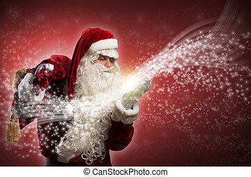 Santa Claus and the magic - santa claus blows with hands...