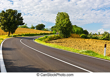 Plowed Fields - Winding Paved Road between Autumn Plowed...