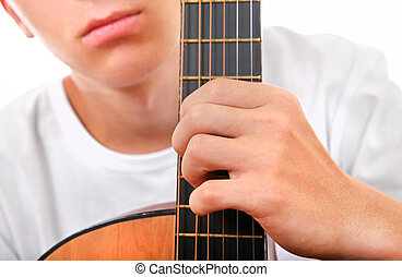 Teenager with Guitar Closeup - Teenager with Acoustic Guitar...