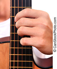 Hand and Guitar closeup - Hand play the chord on Acoustic...