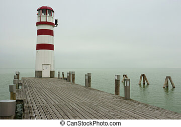 Lighthouse by the Shore - A lighthouse at the end of a...