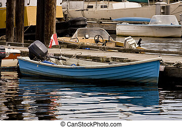 Blue Canadian Boat - A small blue boat with a Canadian flag
