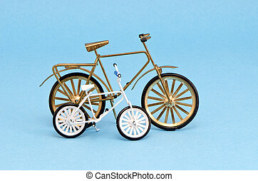two  bicycle model toy on blue background