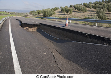 Asphalt road with a crack caused by landslides, Jaen,...