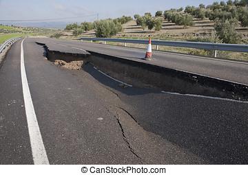 Asphalt road with a crack caused by landslides, Jaen,...