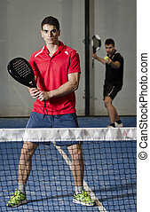 Paddle tennis copule - Indoor paddle tennis couple ready for...