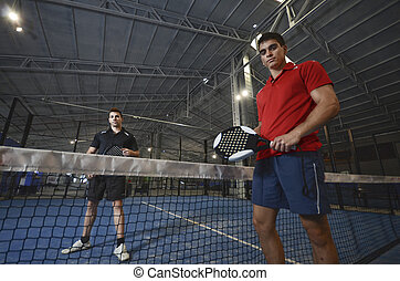 Paddle tennis copule - Paddle tennis couple posing in blue...