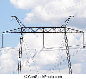 electrical powerlines with blue sky and white clouds...
