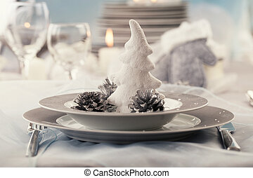 Christmas table setting. Restaurant place setting in elegant...