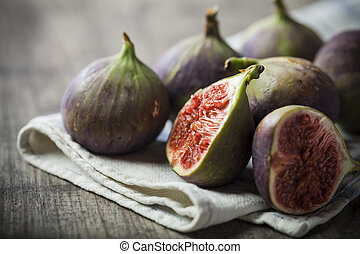delicious figs on wooden background