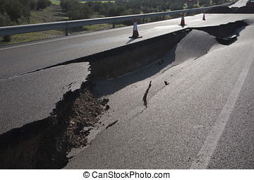 Asphalt road with a crack caused by landslides, Ja?n,...
