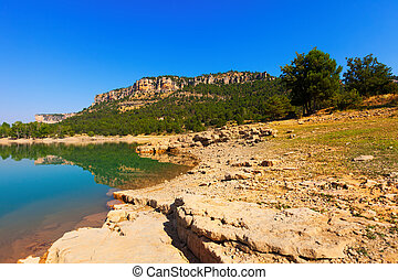 view of rocky mountains lake in sunny summer day