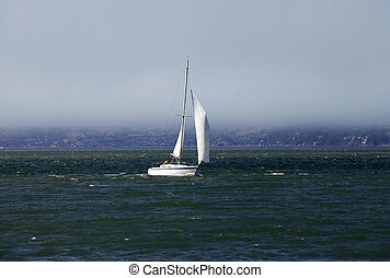 sailing boat in waters in a gulf of silent ocean of San...