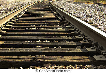 railroad tracks - closeup view of railroad tracks curving...
