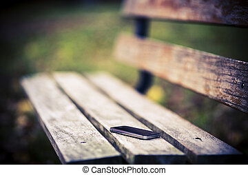 Lost phone on the bench - Someone forgot cell phone on a...