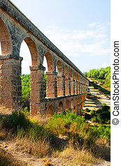 ancient aqueduct in sunny day - ancient aqueduct in sunny...