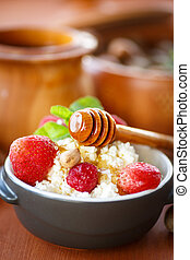 cottage cheese with fresh fruit and honey in a bowl