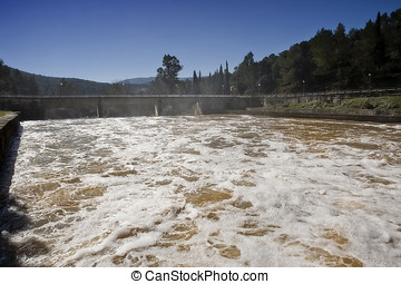 Expulsion of water after heavy rains in the embalse de...