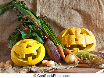 Halloween pumpkin and harvested vegetables on sacking