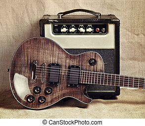 Electric Guitar and Amplifier - black electric guitar and...
