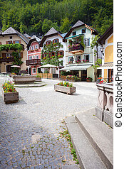 Colorful houses village square in Hallstatt - Public water...