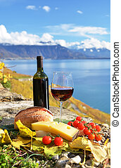 Red wine, chees, bread and cherry tomatos. Lavaux,...
