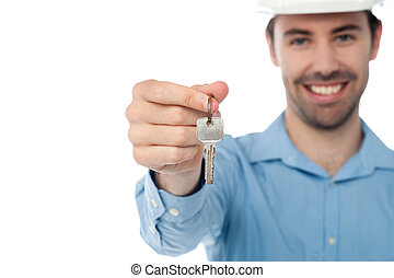 Male offering you office key - Smiling civil engineer...