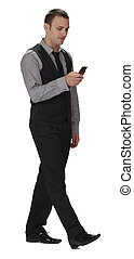 Young Man Walking while Checking his Mobile