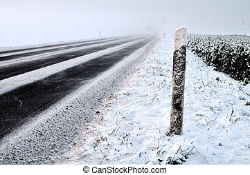 Street in Winter - Snow covered winter road with car and...