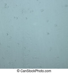 Rain drops in a window - Blurry rain drops in a window
