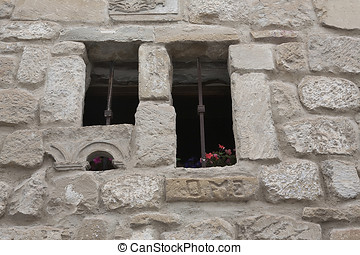 Stone window with archaeological remains, Ubeda, Spain -...